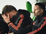 A dejected Louis van Gaal, the manager of Manchester United reacts during the UEFA Champions League group B match between VfL Wolfsburg and Manchester United at the Volkswagen Arena on December 8, 2015 in Wolfsburg, Germany.     WOLFSBURG, GERMANY - DECEMBER 08. (Photo by Stuart Franklin/Bongarts/Getty Images)