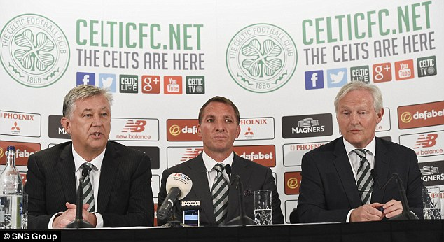 Rodgers sits with Celtic chief executive Peter Lawwell (left) and chairman Ian Bankier (right)