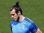 epa05326307 Real Madrid's Welsh winger Gareth Bale performs during his team's training session at the Valdebebas's sports complex in Madrid, Spain, 24 May 2016. Real Madrid will face Atletico Madrid in the 2016 UEFA Champions League final at Guiseppe Meazza stadium in Milan, Italy on 28 May 2016.  EPA/CHEMA MOYA