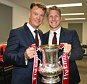 LONDON, ENGLAND - MAY 21:  (EXCLUSIVE COVERAGE) Manager Louis van Gaal and Bastian Schweinsteiger of Manchester United celebrate in the dressing room with the FA Cup trophy after The Emirates FA Cup final match between Manchester United and Crystal Palace at Wembley Stadium on May 21, 2016 in London, England.  (Photo by Matthew Peters/Man Utd via Getty Images)