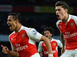 Arsenal's Chilean striker Alexis Sanchez (L) celebrates scoring the opening goal with Arsenal's Spanish defender Hector Bellerin (R) during the English Premier League football match between Arsenal and West Bromwich Albion at the Emirates Stadium in London on April 21, 2016.  / AFP / GLYN KIRK / RESTRICTED TO EDITORIAL USE. No use with unauthorized audio, video, data, fixture lists, club/league logos or 'live' services. Online in-match use limited to 75 images, no video emulation. No use in betting, games or single club/league/player publications.  /         (Photo credit should read GLYN KIRK/AFP/Getty Images)