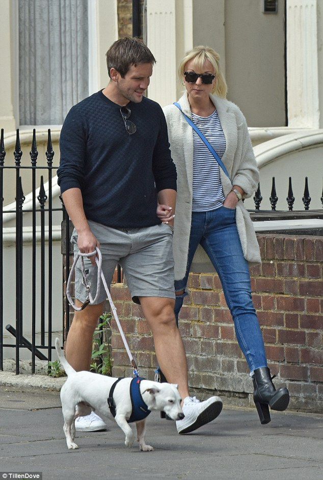 Walkies! The pair certainly looked cosy as they went for a stroll around London arm in arm, with Jack also walking his pet dog