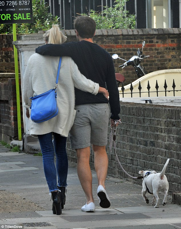 Packing on the PDA: Jack placed his arm affectionately around Helen's shoulders while she wrapped hers around his waist as they strolled along a residential street