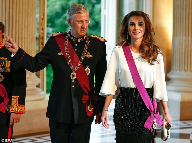 Making friends: Queen Rania is given a royal tour of the palace by her host King Philippe
