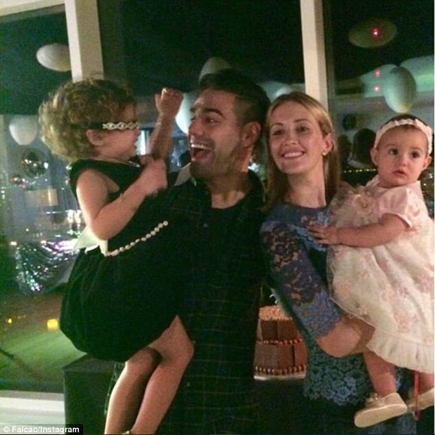 Family man:Radamel and Buenos Aires-born Lorelei met at church when she was  16-years-old and he was 18 before welcoming their two daughters in 2013 and 2015