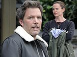 EXCLUSIVE Ben Affleck and Jennifer Garner enjoy a meal out in London with their children and some friends. Affleck, who is currently filming The Justice League Part One where he reprises his role as Batman, was sporting some very un-macho like eye liner as he took a walk home with the rest of the party. Make-up free Jennifer seemed to take it all in her stride though as she smiled at photographers.\n26 May 2016.\nPlease byline: Vantagenews.com\nUK clients should be aware children's faces may need pixelating.