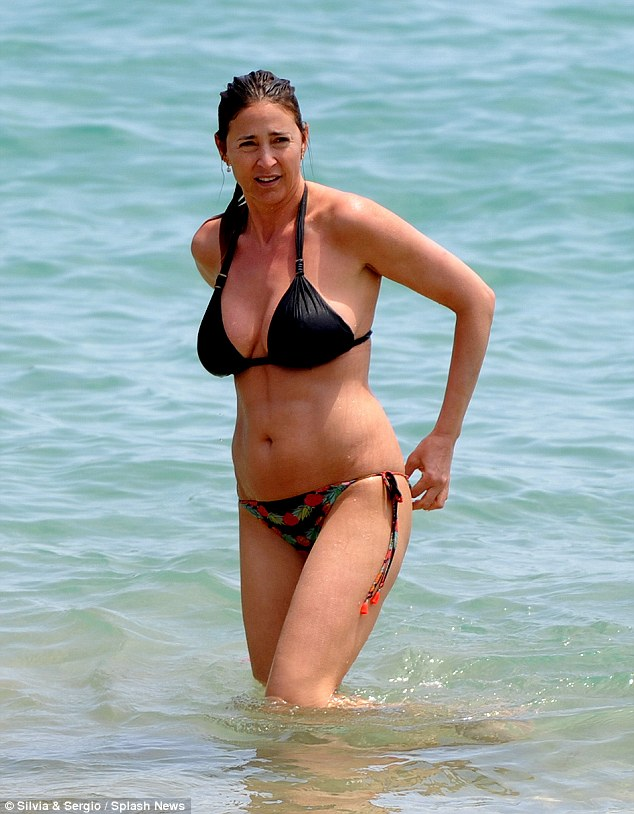 Sizzling: Cooling off in the azure seas of the White Isle, Lisa was bound to set the island's already scorching temperatures soaring as she flaunted her ample assets in a skimpy bikini