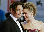 """FILE - In this Sept. 5, 2015 file photo, Johnny Depp, left, and Amber Heard arrive at the premiere of the film """"The Danish Girl"""" during the 72nd edition of the Venice Film Festival in Venice, Italy. Court records show Heard filed for divorce in Los Angeles Superior Court on Monday, May 23, 2016, citing irreconcilable differences. The pair were married in February 2015 and have no children together. (AP Photo/Andrew Medichini)"""