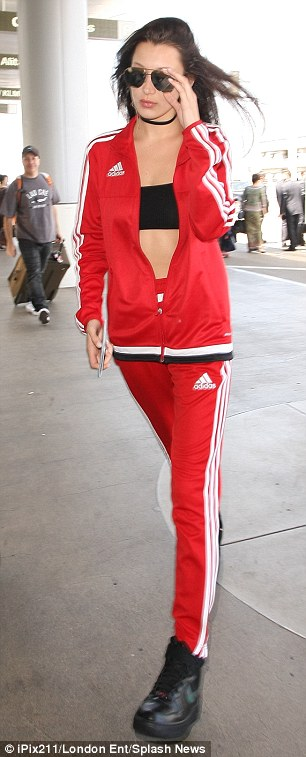 Channeling her inner Sporty Spice:The in demand model wore a matching Adidas tracksuit complete with red sweatpants and a red zip up jacket