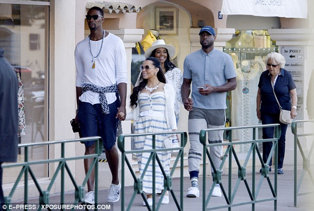 Double date: The couple were joined on holiday by Dwyane's fellow Miami Heat player Chris Bosh, 32, and his 31-year-old model wife Adrienne Williams