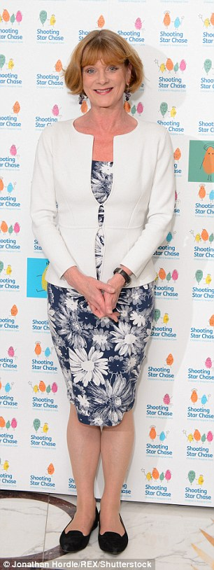 Thespians: Samantha Bond cut a demure figure in a navy floral midi dress and cream cardigan