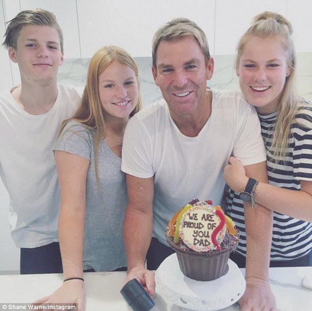 Doting father:Shane Warne has opened up about how he manages to maintain a close bond with his three children Brook, Summer and Jackson despite the months they spend apart