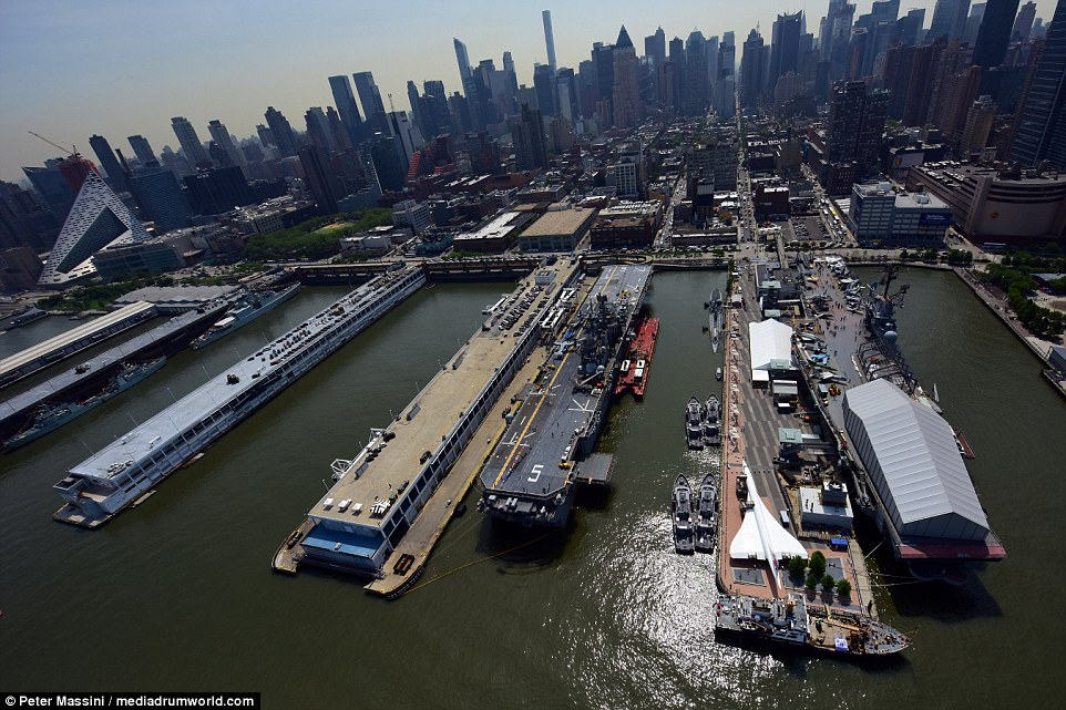 Not a bad backdrop: Concorde (bottom right) is seen on the banks of Hudson River, with the Manhattan skyline pictured behind