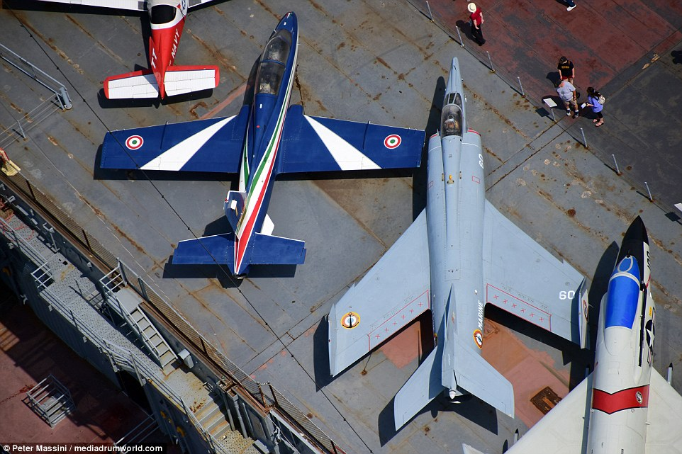 A Harrier jump jet (right) was accompanied by an Italian vintage jet (left), complete with the roundel of the Italian Air Force on each wing