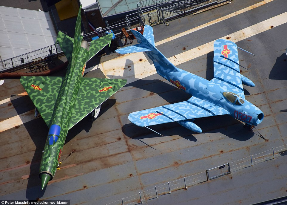 Two Vietnamese planes - including a blue camouflage PZL-Mielec Lim-5 (MiG-17F) - sat alongside the US planes on deck