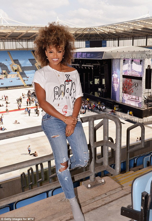 Keeping it casual: The fashionable star sported ripped jeans and a loose T-shirt as she hung out backstage before her performance