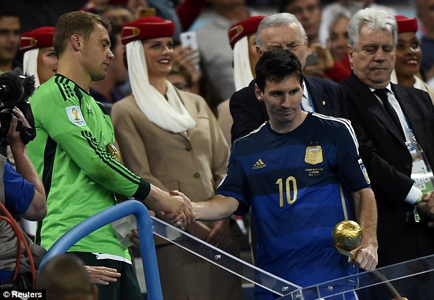Regret: Messi didn't look pleased with the Golden Ball award - he was hoping to take home a different trophy