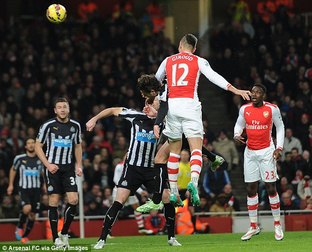 Olivier Giroud (centre) rises highest to head Arsenal into the lead against Newcastle in the Premier League