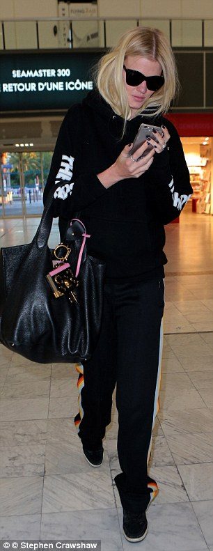 Checking out: David Walliams' ex was very low-key as she jetted out of France the next day