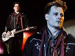 Johnny Depp, guitarist of US band Hollywood Vampires, performs at the Rock in Rio Lisboa music festival at Bela Vista Park in Lisbon on May 27, 2016. Rock in Rio runs from May 19 to May 29, 2016.  / AFP PHOTO / PATRICIA DE MELO MOREIRAPATRICIA DE MELO MOREIRA/AFP/Getty Images