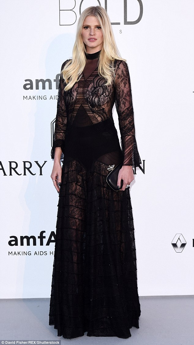 Busty babe: Earlier in the evening, Lara shocked in an entirely sheer gown on the red carpet
