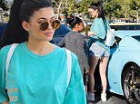 Malibu, CA - Kylie Jenner wears turquoise blue for a shopping trip to Planet Blue in Malibu. The young reality star got some help with her shopping bags to turquoise blue Ferrari.\nAKM-GSI   May  27, 2016\n \nTo License These Photos, Please Contact :\n \nSteve Ginsburg\n(310) 505-8447\n(323) 423-9397\nsteve@akmgsi.com\nsales@akmgsi.com\nor\nMaria Buda\n(917) 242-1505\nmbuda@akmgsi.com\nginsburgspalyinc@gmail.com