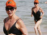 *PREMIUM EXCLUSIVE* Oahu, HI - Goldie Hawn is spotted taking a dip in the warm waters while in Oahu. The actress looks fit and toned as she walks from the shore back to the sand. She shows off her great physique and proves that you can look good at any age. She was sure to protect her face by wearing an orange cap and sunglasses. \nAKM-GSI        May 20, 2016\nTo License These Photos, Please Contact :\nSteve Ginsburg\n(310) 505-8447\n(323) 423-9397\nsteve@akmgsi.com\nsales@akmgsi.com\nor\nMaria Buda\n(917) 242-1505\nmbuda@akmgsi.com\nginsburgspalyinc@gmail.com