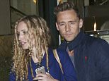 Picture Shows: Tom Hiddleston  May 25th, 2016    * Embargo - Strictly no web / online use permitted before 27th May 2016 GMT * Fee On 27th �250 For Set *    Tom Hiddleston was seen leaving The Ivy Club in London, England. Tom collided with a young blonde woman and appears to be holding what could possibly be a film script. When asked if he was the new 007, Tom smiled.    * Embargo - Strictly no web / online use permitted before 27th May 2016 GMT * Fee On 27th �250 For Set *    Exclusive All Rounder  WORLDWIDE RIGHTS  Pictures by : FameFlynet UK � 2016  Tel : +44 (0)20 3551 5049  Email : info@fameflynet.uk.com