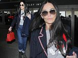 Los Angeles, CA - Demi Moore dons a cute Mickey Mouse tee as she returns to her beloved Los Angeles after shinning on the red carpet for Vogue's Centenary gala dinner.\nAKM-GSI       May 27, 2016\nTo License These Photos, Please Contact :\nSteve Ginsburg\n(310) 505-8447\n(323) 423-9397\nsteve@akmgsi.com\nsales@akmgsi.com\nor\nMaria Buda\n(917) 242-1505\nmbuda@akmgsi.com\nginsburgspalyinc@gmail.com