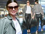 May 25, 2016: Miranda Kerr jets out of New York City from JFK airport. Mandatory Credit: PapJuice/INFphoto.com infusny-286