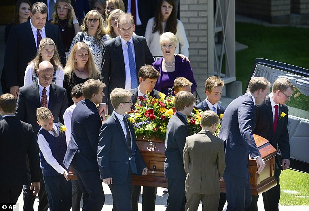 Friends and family watch as Bennett's casket is taken from the Federal Heights Ward Chapel for it's short trip to interment services at the Salt Lake City Cemetery on Saturday, May 14, 2016. Funerals were helped for the former senator in both Utah and Washington, DC