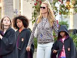 """EXCLUSIVE: Heidi Klum and her children enjoy a day at Universal Studios Hollywood, but actually just spent the entire time at the Wizarding World of Harry Potter. Each one of her children donned a Harry Potter cape and each got a magic wand that they happily waved around the park. The Family, joined by a VIP tour guide and a single bodyguard were seen hopping on the two rides in the area several times. They rode the """"Harry Potter and the Forbidden Journey' about four times and """"Flight Of the Hippogriff"""" (pictures) five or six times. the kids just couldn't have enough! Heidi was happy to ride with each of her kids on the small rollercoaster, and also enjoyed the forbidden journey, although she and Lenny  decided to not ride on the last time around. Instead, the two were seen hanging out walking around and checking things out just the two of them. Heidi and Lenny can also be seen enjoying enjoying a sweet treat while out on their own  Pictured: Heidi Klum, Lenny Samuel, Lou Samuel, Jo"""