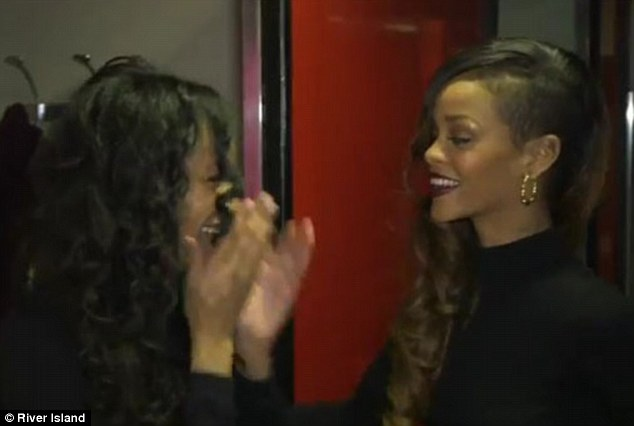 Surprise! Rihanna shocks a stunned fan who is trying on a dress from her new River Island collection in the changing room