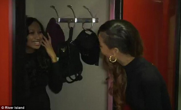 Over the moon: The shopper seems overjoyed to see her idol close-up