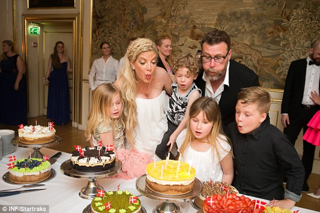 Make a wish: Tori 's family helped her to blow out the birthday candles