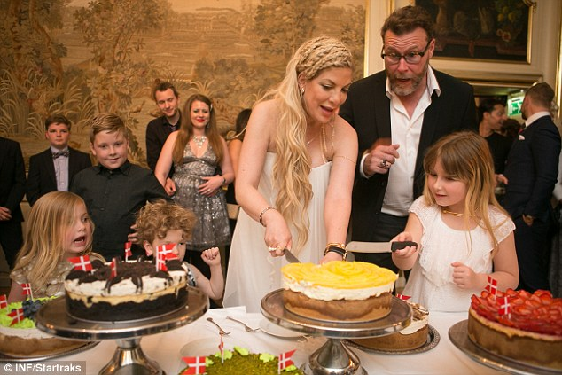 Cutting the first piece: The reality star showed she's handy with the chef's knife as she portioned out the cake