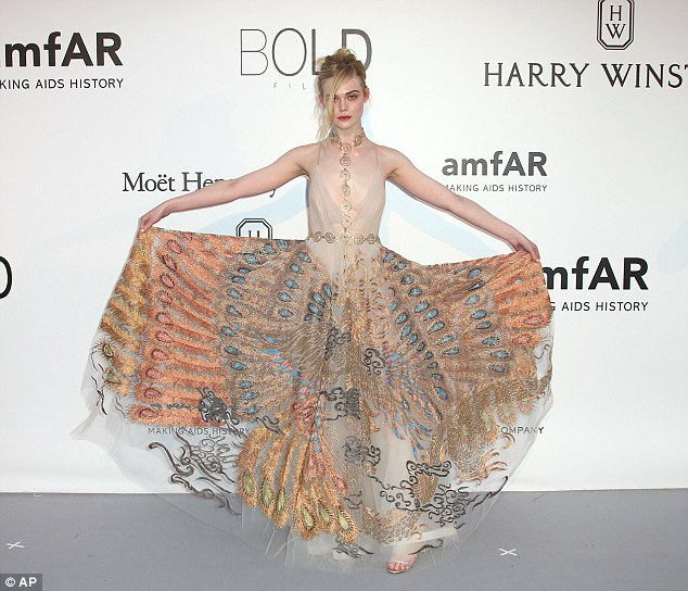 Striking: The Maleficent actress' statement garment was set off with a beautiful gold necklace running down the centre of her dress and around the waist