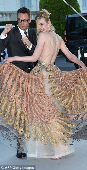 Getting the giggles: Elle was in high spirits as she twisted and twirled in her gorgeous gown