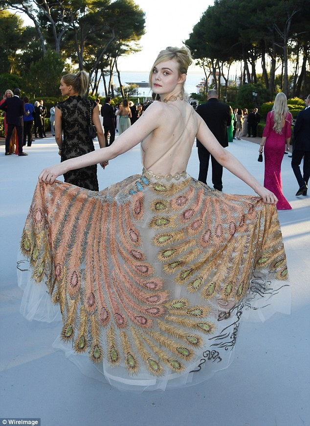 Taking flight: Elle's backless dress ensured she looked every inch the silver screen siren