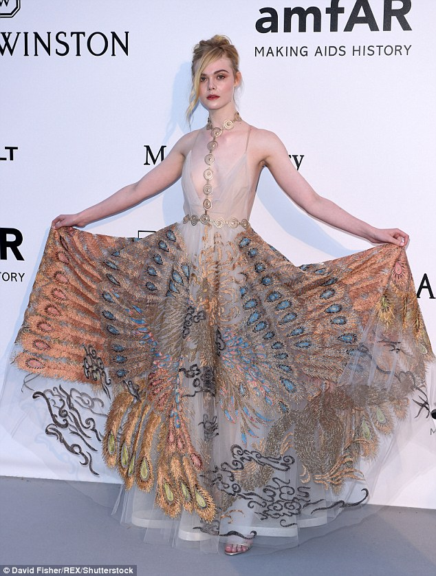 Ruling the roost: Elle Fanning looked incredible in a peacock patterned gown as she arrived atamfAR's 23rd Cinema Against AIDS Gala at Hotel du Cap-Eden-Roc in Cap d'Antibes, France on Thursday night