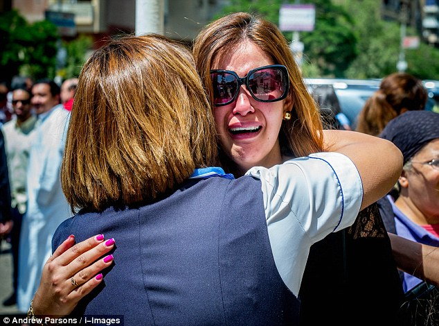 Gripped by grief: EgyptAir stewardesses console each other outside the Al Sedeq mosque where hundreds of mourners gathered to offer prayers for the crew of missing EgyptAir flight MS804