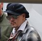 CAPTION Johnny Depp leaves his hotel in Frankfurt, Germany. The actor, who has been accused of domestic violence by his estranged wife Amber Heard, made a low-key exit from the back of the Villa Kennedy wearing a black and white coat, hat and sunglasses on May 29, 2016. Depp is in Frankfurt for a concert with his band, The Hollywood Vampires. The actor's wife, Amber Heard, filed for divorce on May 23. She filed a restraining order against Depp four days later, accusing him of attacking her and alleging repeated incidents of domestic violence.  BYLINE Splash News