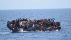 Dramatic video shows migrant boat capsizing
