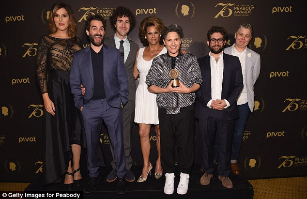Time to celebrate: Our Lady J, Jay Duplass, Ethan Kuperberg, Alexandra Billings, Jill Soloway, Joe Lewis and Ali Liebegott from the TV show Transparent pose with a Peabody Award