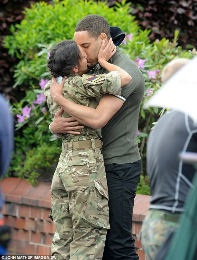 Passionate:Michelle was seen putting both hands on her handsome co-star's face as he wrapped his arms around her for the intimate kiss