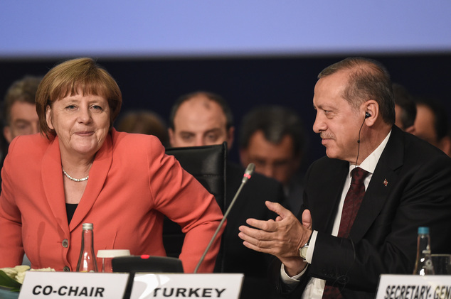 "German Chancellor Angela Merkel, is applauded by Turkey's President Recep Tayyip Erdogan, following her speech during a roundtable meeting on ""Political Lead..."