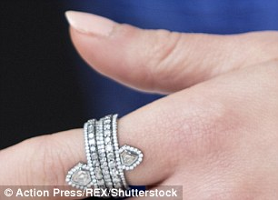 All that glitters: Emilia rounded off her A-list style with some show-stopping jewelry including a prominent diamond encrusted ring