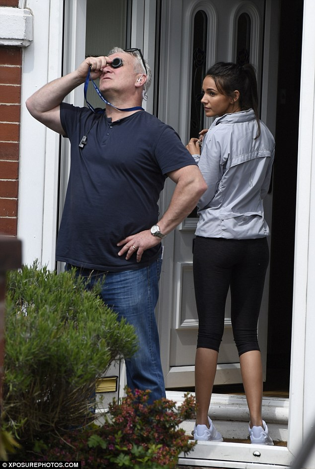 In action: Michelle was seen heading into a house as part of the shooting