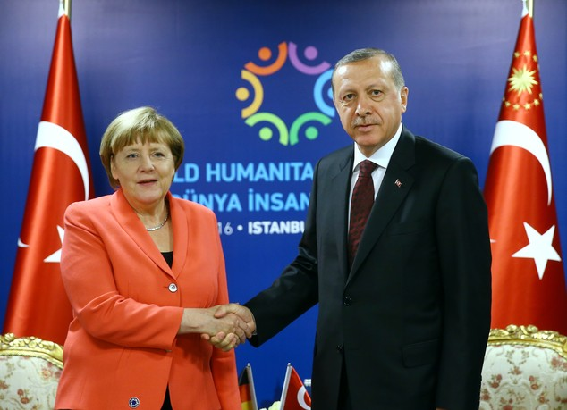 Turkey's President Recep Tayyip Erdogan, right, shakes hands with German Chancellor Angela Merkel, prior to their meeting at the World Humanitarian Summit in...