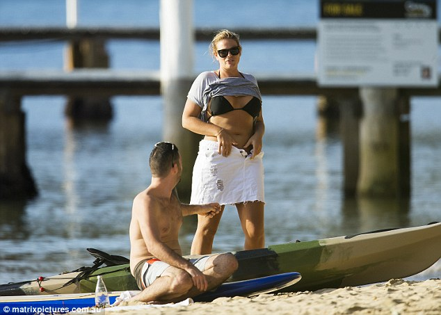 Beachside love: Fiona Falkiner and her restaurateur beau were seen soaking up the sun at a beach on Sydney's Northern Beaches last month